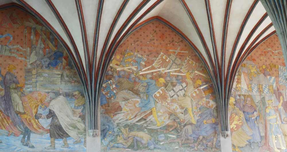 Taistelevia teutoneja seinämaalauksessa