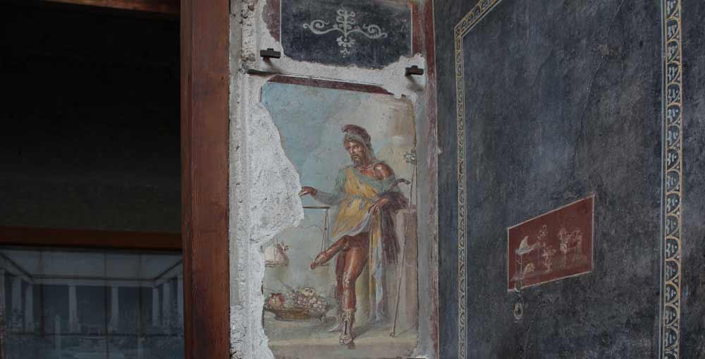 Valtavalla falloksella varustettu Priapos-jumalan kuva. Seinämaalaus.