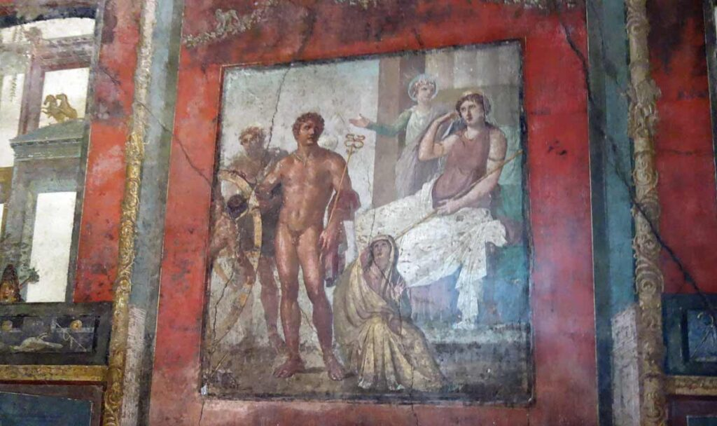 Iksionin rangaistusta esittävä seinämaalaus Veriiusten talossa.